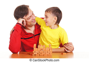father plays with son - portrait of a father playing with...