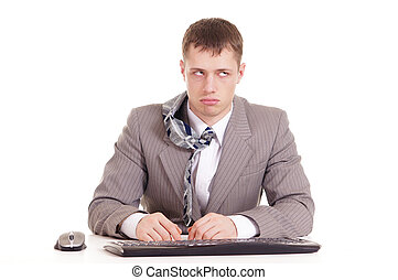 businessman in a suit sitting at a computer