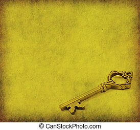 old key on the old textured paper