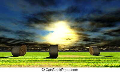 Straw bales on field against sky