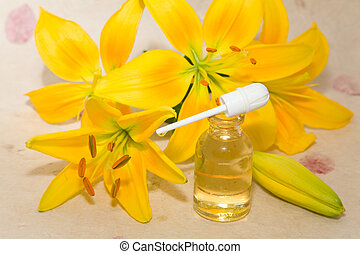 bottles of aromatic oil and lily flower - bottles of...