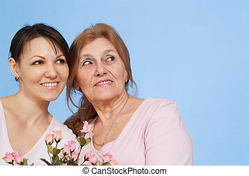 Good Caucasian elderly woman and her daughter