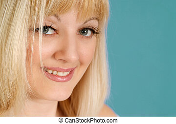 Portrait of a beautiful nice blonde Caucasian lady with flowers