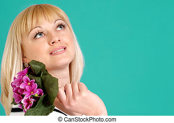 Portrait of a beautiful blonde Caucasian female with flowers