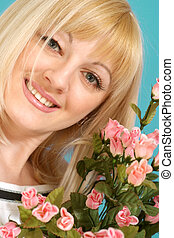 Portrait of a beautiful blonde Caucasian nice lady with flowers