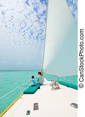 Family sailing on luxury yacht - Mother and son relaxing...