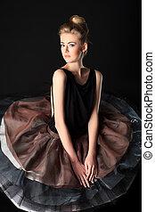 full skirt - Beautiful ballet dancer posing at studio.