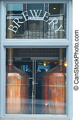 Micro Brewery - Looking through a window at copper beer vats