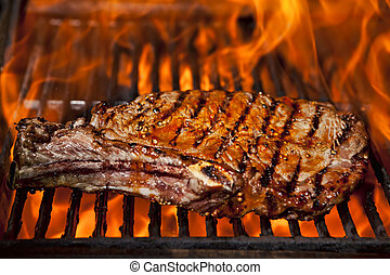 Top sirloin steak - A top sirloin steak flame broiled on a...