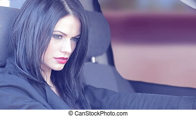 Single woman in car - Single woman with long black hair in...