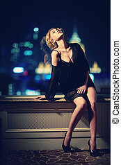 At hight - Beautiful girl in the window at night