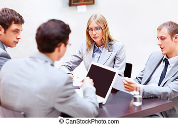 Workgroup - Businessmen with laptop in office