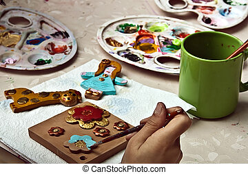 Children painting pottery 5 - Children painting pottery at a...