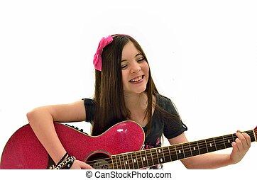 Making music - Ten year old girl making music
