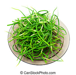 Fresh garlic scapes on plate. Isolated on white background.