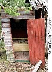 Old outhouse - Old abandoned outhouse almost falling down