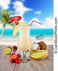 Summer drink - Pina colada drink with blur beach on...