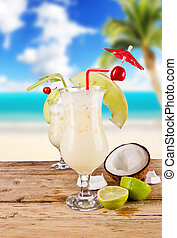 Summer drinks - Pina colada drinks with blur beach on...