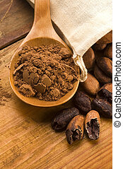 Cocoa cacao beans on natural wooden table