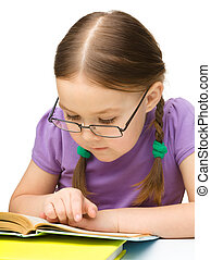 Cute little girl reading book wearing glasses, isolated over...