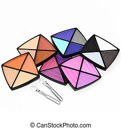 Set of multicolor eyeshadows and two applicators.