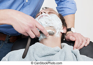 Man Getting Shaved