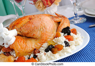 Grilled chicken with rice and dried fruits closeup