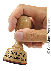 rubber stamp marked with quality management