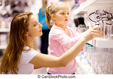 mother and daughter shopping for homeware