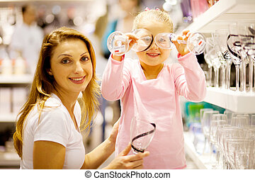 mother and daughter shopping homeware