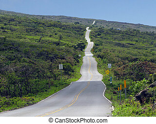 Rolling Road - undulating paved road in remote area of Maui