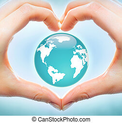 Love to earth - Creative image of earth model inside heart...