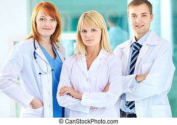 Group of practitioners - Portrait of three clinicians in...