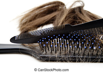 Hairbrush and comb to white background