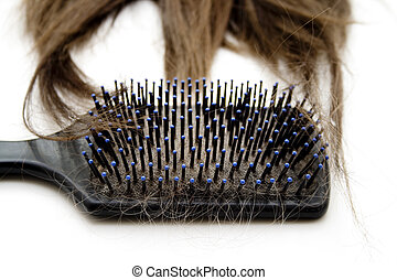 Hairbrush with hairpiece on white background