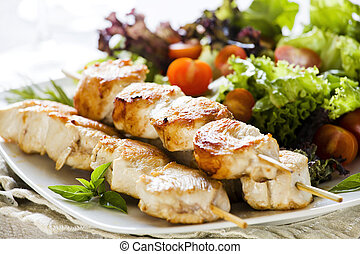 Chicken Skewers - Close up photograph of three chicken...