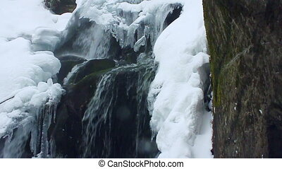 Winter waterfall. Shot with slider. Slow-motion.