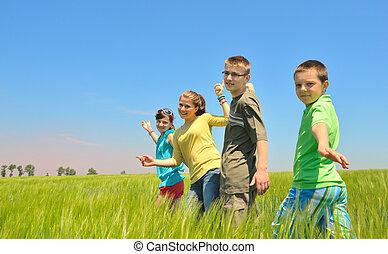 kids play in wheat field