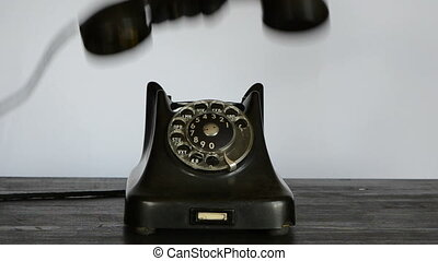 hand with black glove calling with phone
