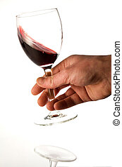 red wine degustation - Person holding a half full glass of...