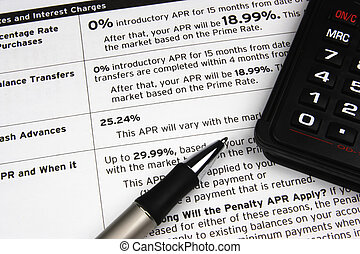 Calculator on Credit Terms - A pen and calculator on top of...