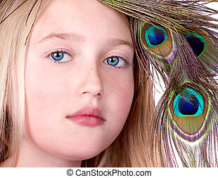 Beautiful Girl with Peacock Feather head dress, close-up...