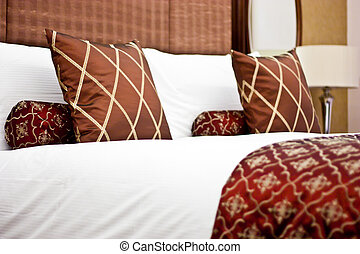 Pillows in Hotel bedroom - Concept for luxury and Honeymoon,...
