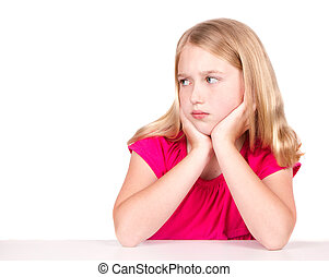 Angry or upset child looking to the side