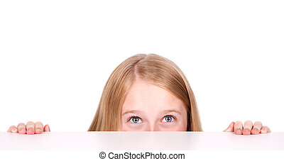 Girl peeking from behind table - Girl or teen peeking from...