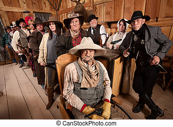 Serious Group of People in Old West Tavern - Calm men and...