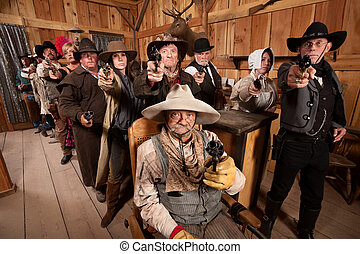 Tough People with Guns in Old Saloon