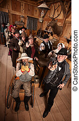 Serious Crowd with Guns in Saloon - Serious people in old...