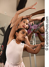Ballet Students Exercising - Ballet students stretch out and...