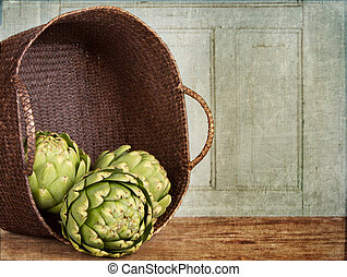 artichokes spilling out of a basket, with a grunge...